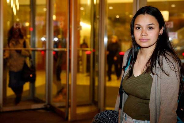 Nancy Villa stands in front of Harold Washington College in November. Ms. Villa was brought to the United States illegally from Mexico while a child. She has a work permit through a 2012 federal program started under Obama's administration and works at a Chicago child-care center and attends college, She and three siblings have DACA, while two siblings are US citizens. (Photo: Nam Y. Huh | AP)